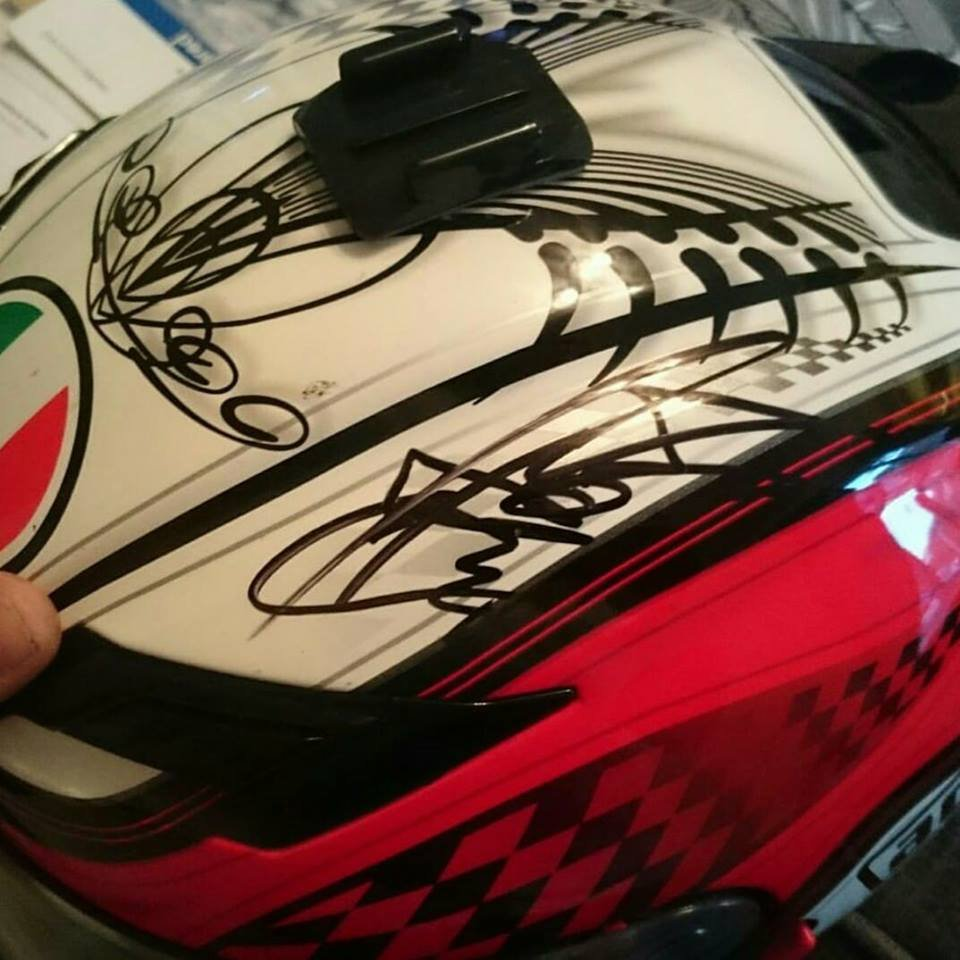 Alex Groome's AGV signed by Foggy and Guy Martin