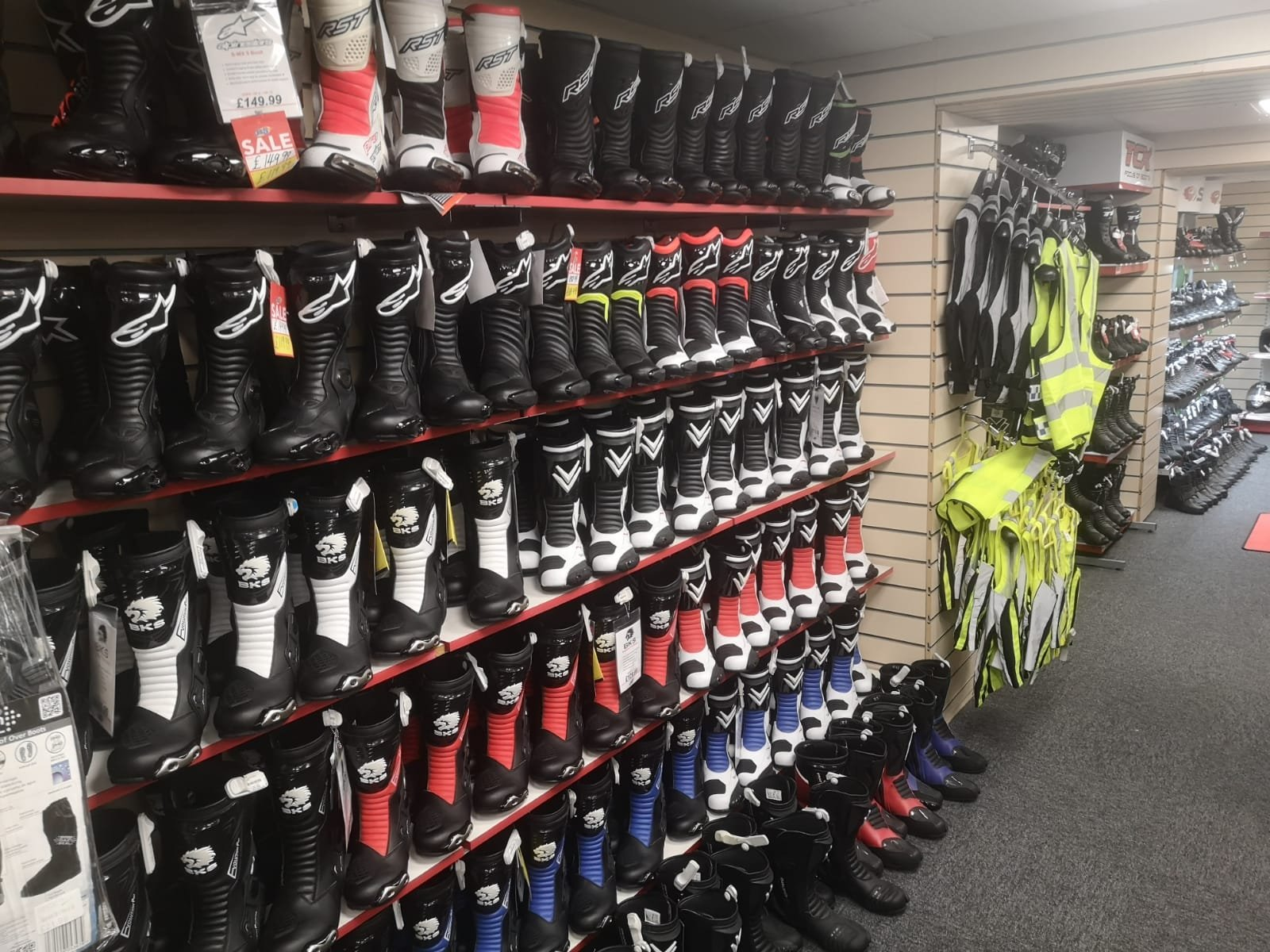 A wall of motorcycle race boots