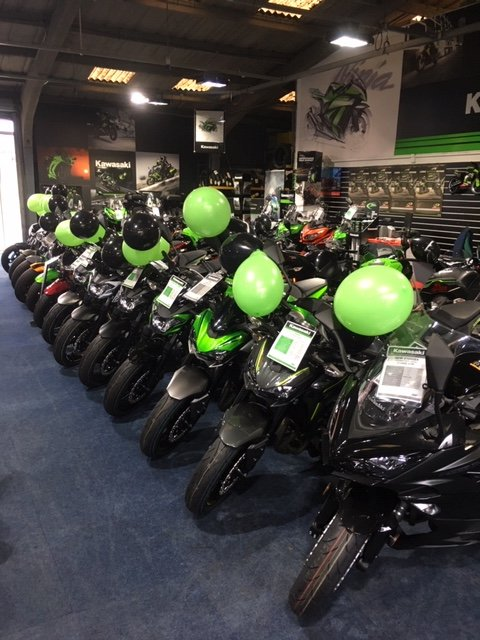 New 2019 model Kawasaki's all lined up with balloons.